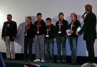 Members of the Children's Film Festival jury award the Michel prize. (Photo by Shelly Schoeneshoefer)