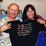 Hammond Peek and Osanna Vaughn show off an official crew t-short from The Lord of the Rings.